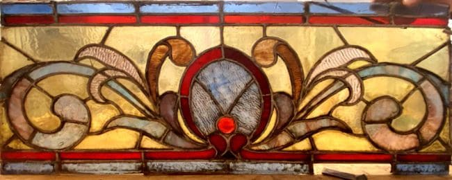 Damaged and dirty stained glass panel