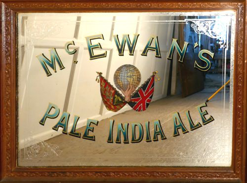 Beveled mirror with bar sign